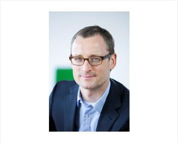 Porträtfoto des Vorstands Dr. Rainer Barth der Soennecken eG